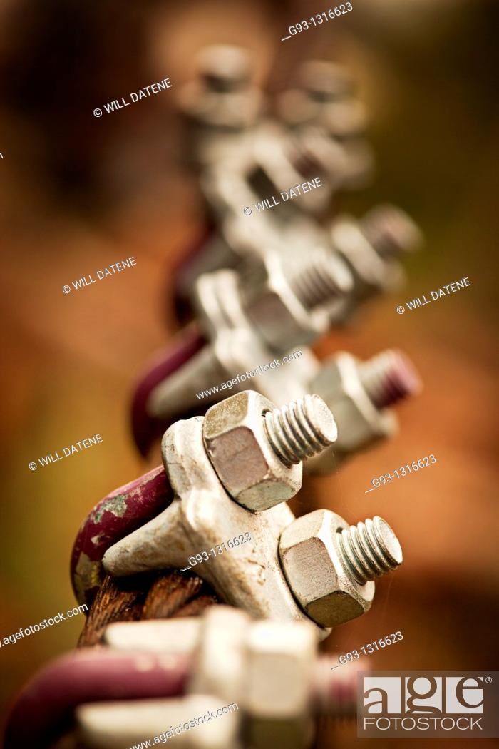 Stock Photo: Close-up of cable clamps with selective focus.