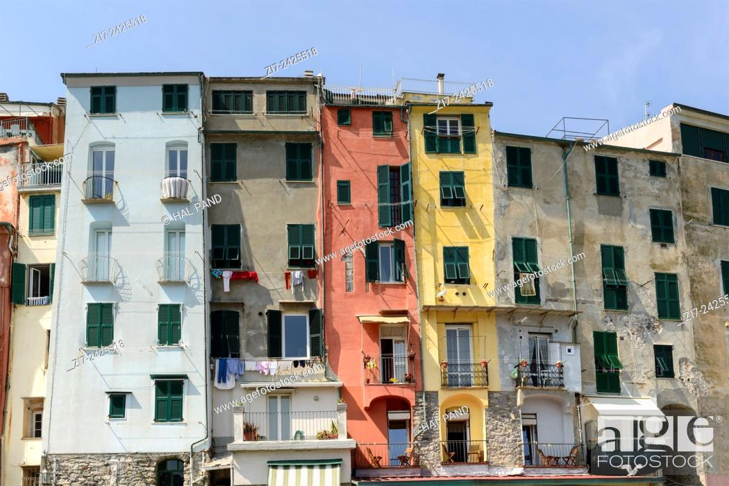 Stock Photo: view of a row of historical traditional houses on embankment in a sunny spring day, Portovenere, italy.