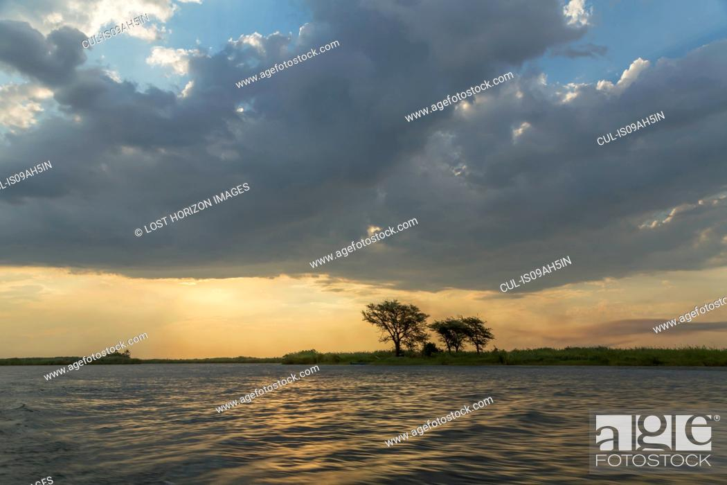 Stock Photo: Water and silhouetted trees, Kasane, Chobe National Park, Botswana, Africa.