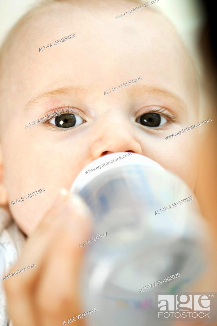 Stock Photo: Baby drinking from bottle.