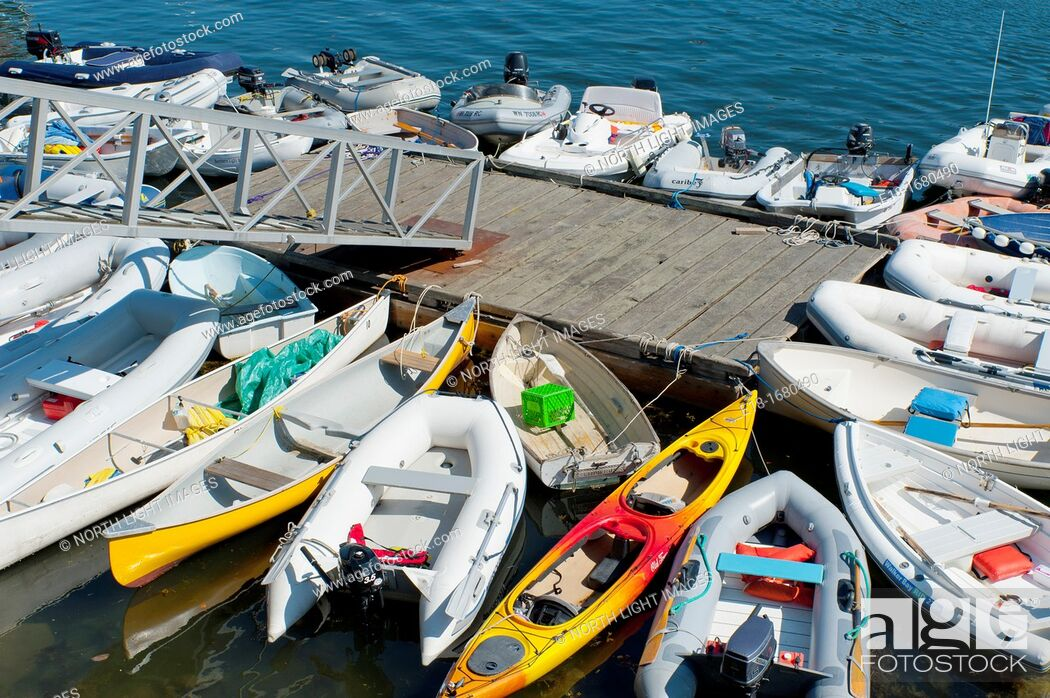 Stock Photo: Canada, BC, Saltspring Island, Ganges harbour  A cluster of small boats tied up to the public dock  Includes kayaks, canoes, zodiaks, and motorboats.