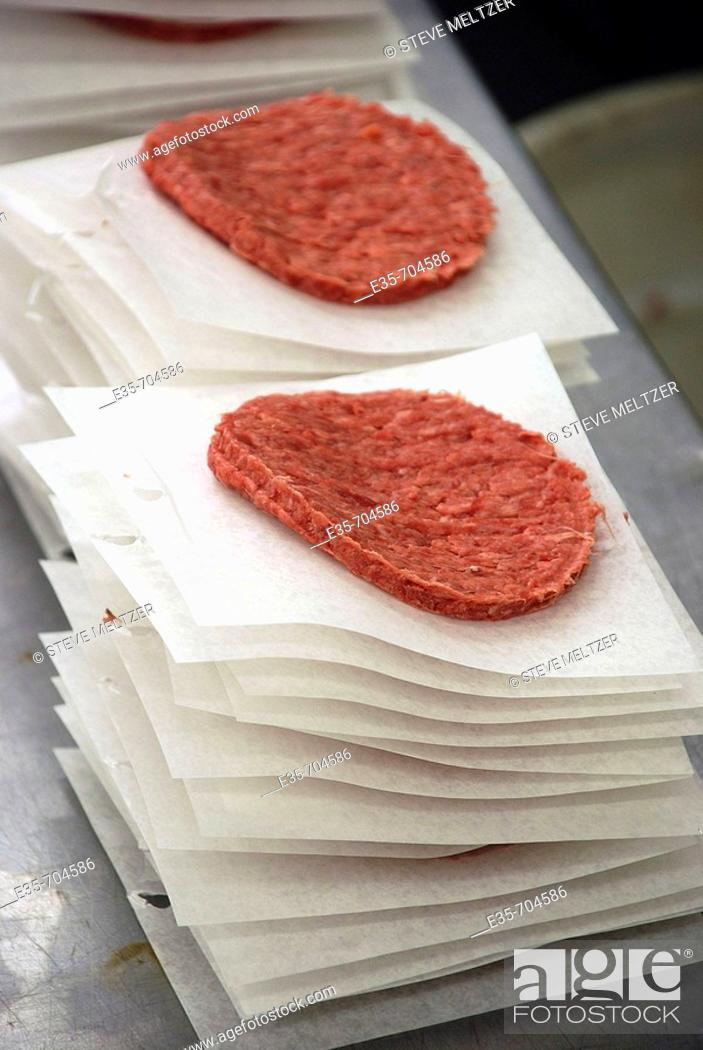 Stock Photo: Hamburger patties, prepared food, meat factory, pre-shaped meat, meat production, meat processing plant.