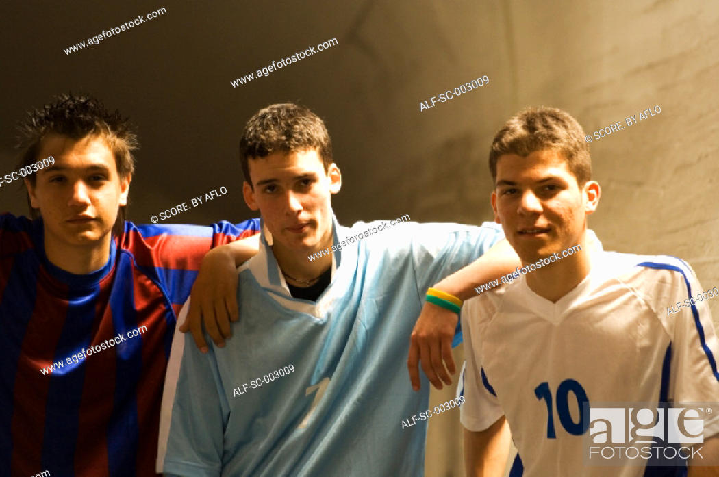 Stock Photo: Group of teenage soccer friends.