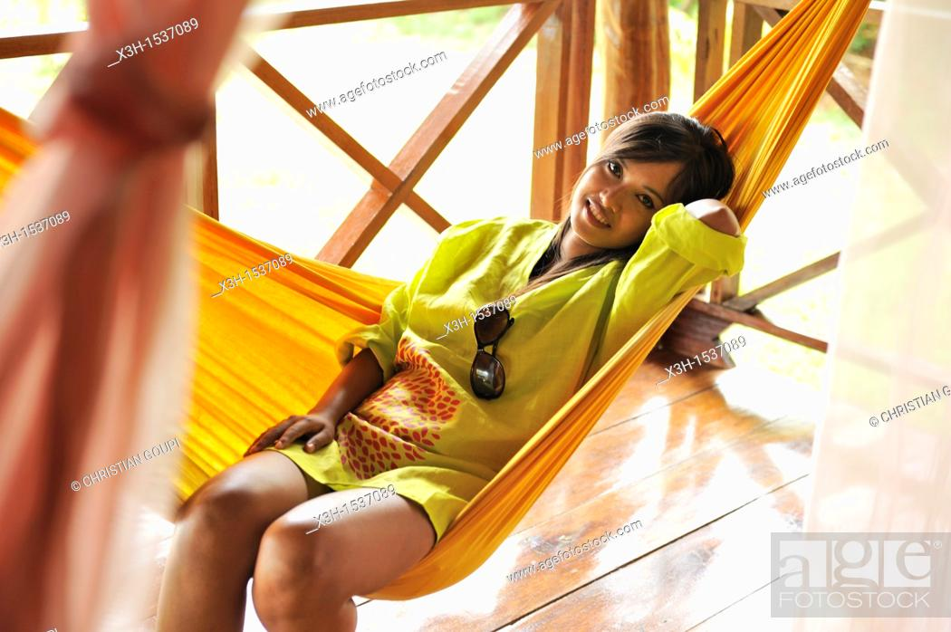 Stock Photo: Young woman lying in hammock, Koh Jum Lodge, Koh Jum Island, Krabi, Thailand, Asia.