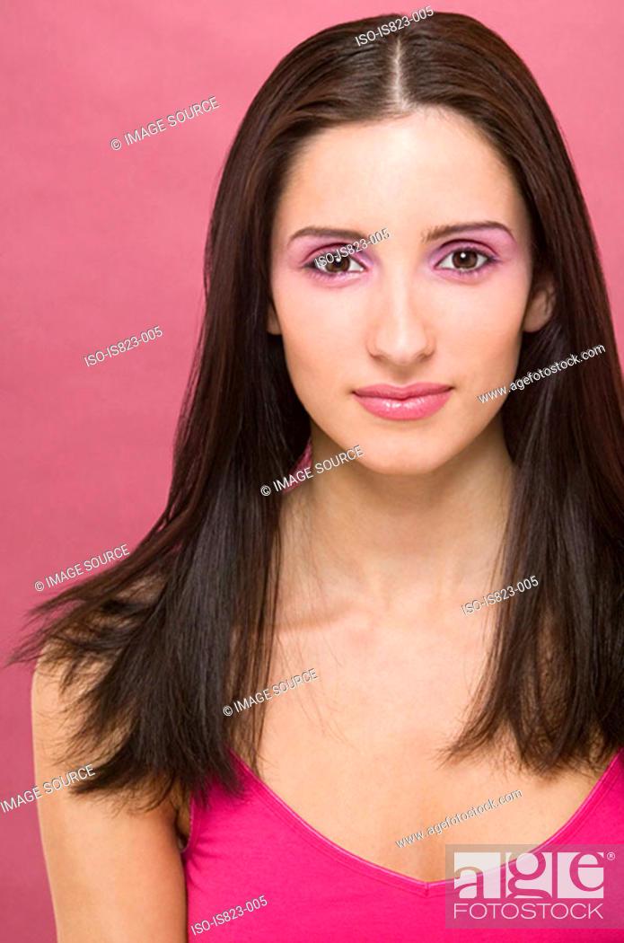 Stock Photo: Hispanic woman wearing pink lipstick.
