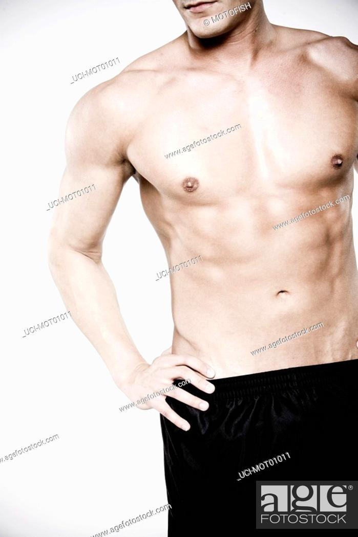 Stock Photo: Bare-chested man with hand on hip.