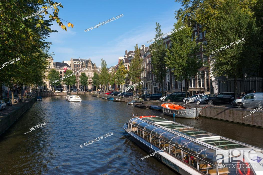 Stock Photo: The Netherlands, Europe, sailing boat in Amsterdam canal.