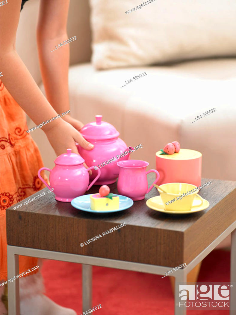 Stock Photo: girl playing tea house with toys.