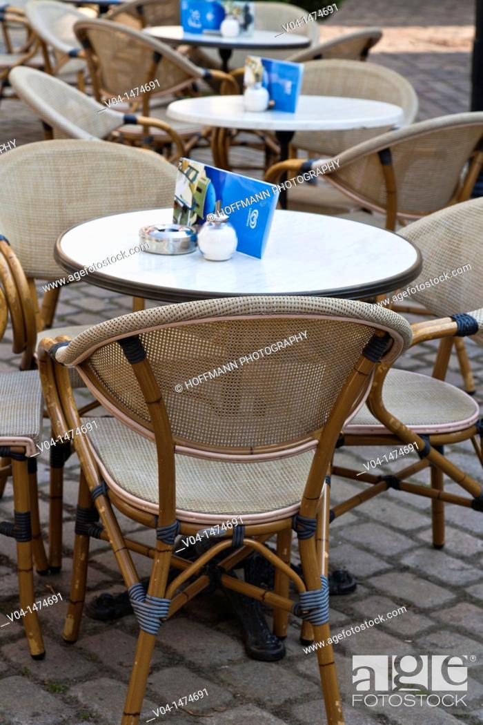 Stock Photo: Deserted tables outside a restaurant in the rain, Bremen, Germany, Europe.