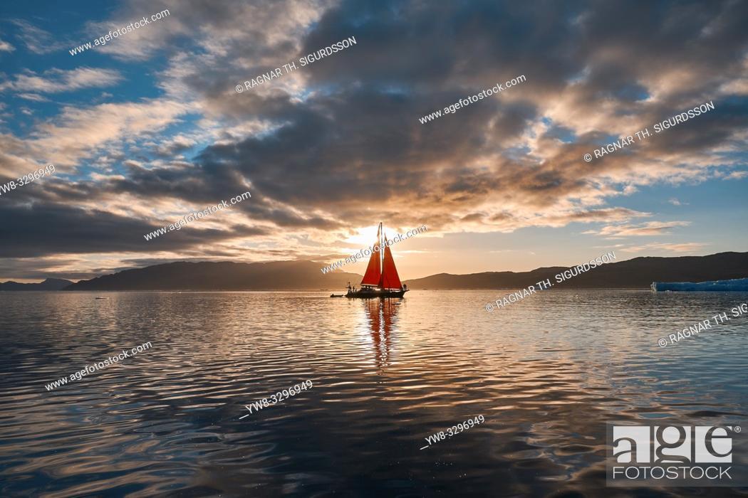 Stock Photo: Sailboat at sunset, Icefjord, Greenland.
