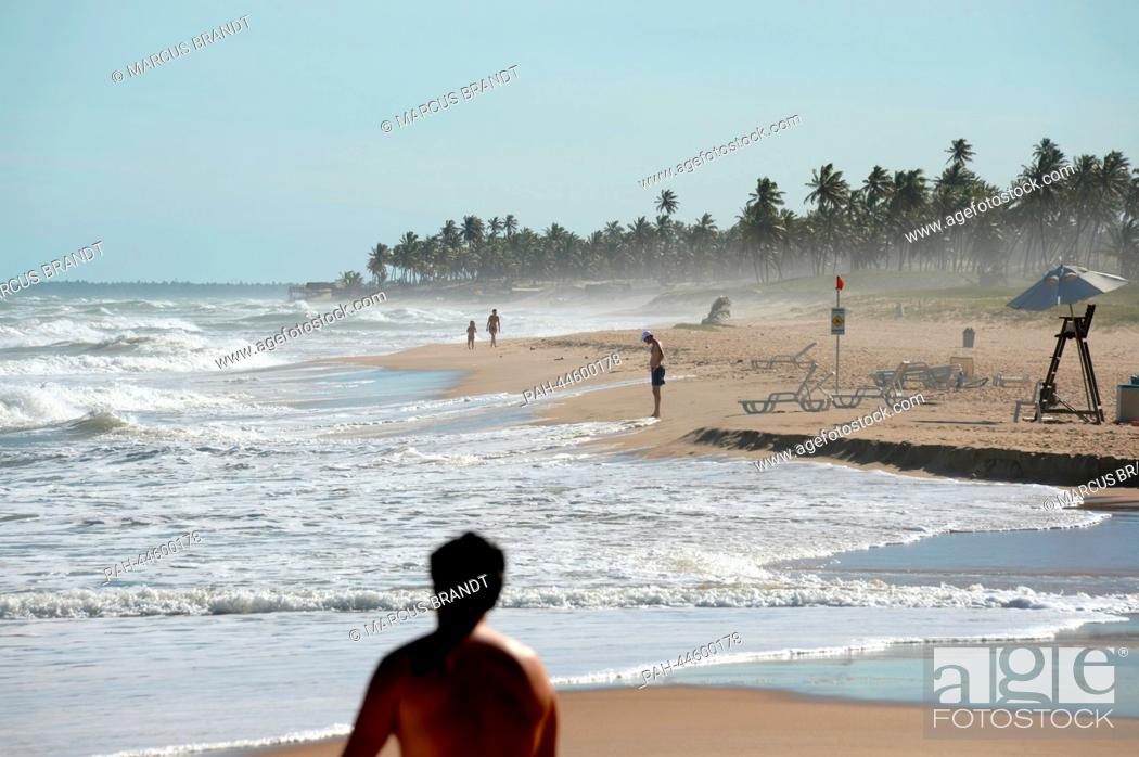 Stock Photo: People relax on the beach in Costa do Sauipe, Brazil, 03 December 2013. The final draw for the preliminary round groups of the 2014 FIFA world cup Brazil will.