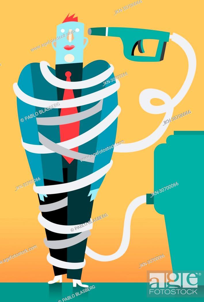Imagen: Businessman wrapped in fuel pump hose.