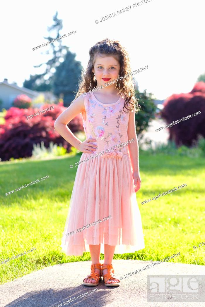 Stock Photo: Portrait of a five year old girl wearing makeup and a pretty dress before a dance performance at a ballet.