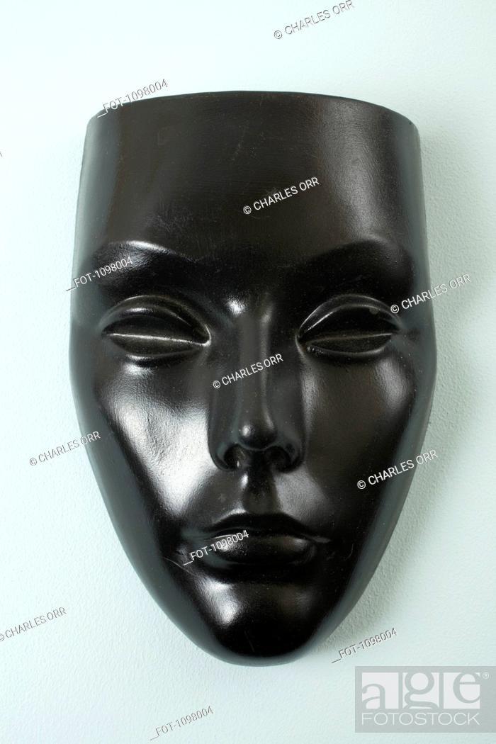 Stock Photo: A black mask, female likeness.