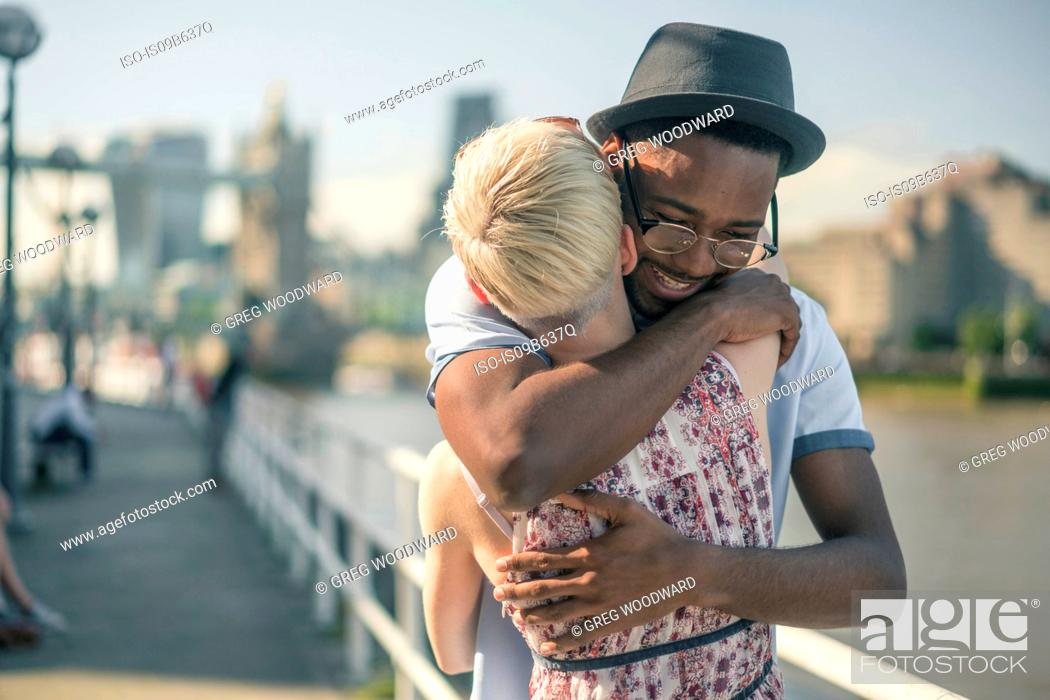Photo de stock: Young couple outdoors, hugging.