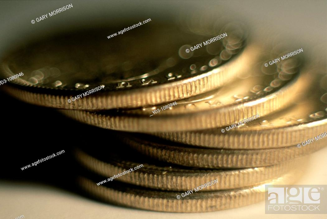 Stock Photo: Stack of silver dollar coins, US currency.