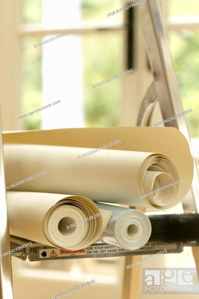Stock Photo: Close-up of rolls of wallpapers.