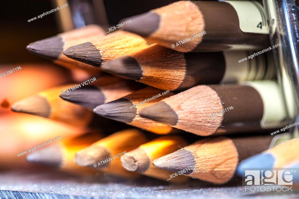 Stock Photo: colour pencils stacked in horizontal position.
