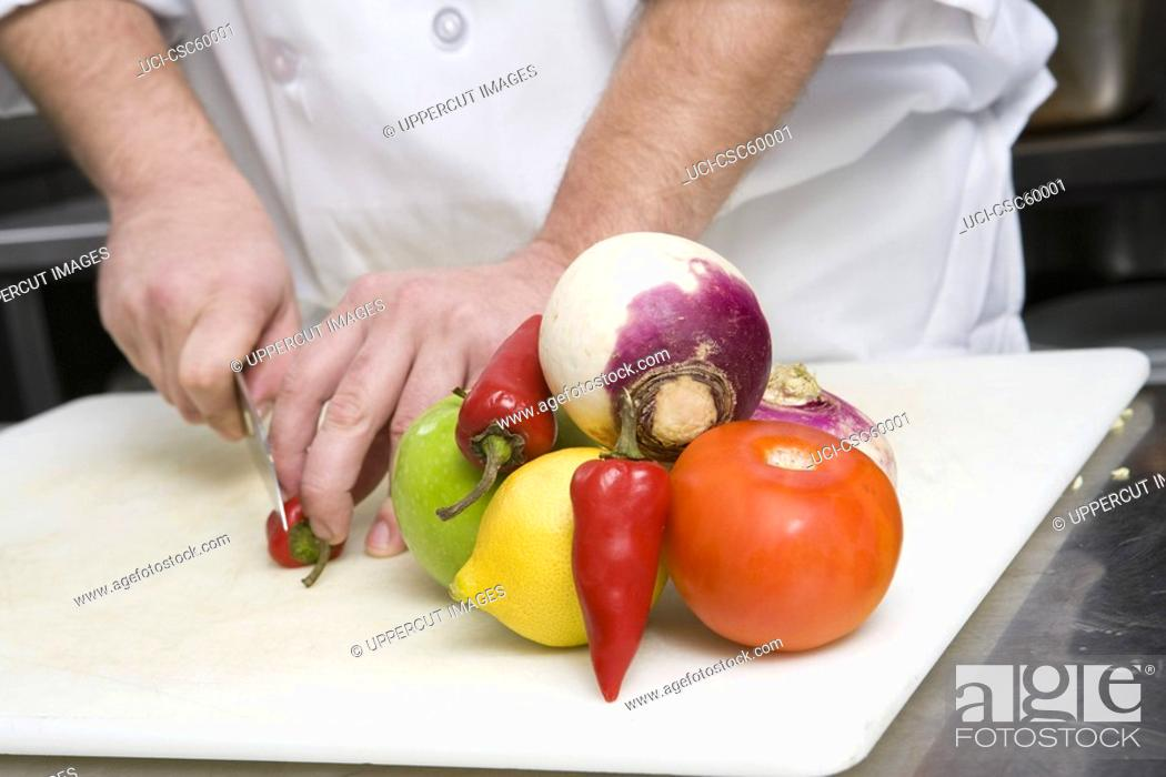 Stock Photo: Chef chopping vegetables.