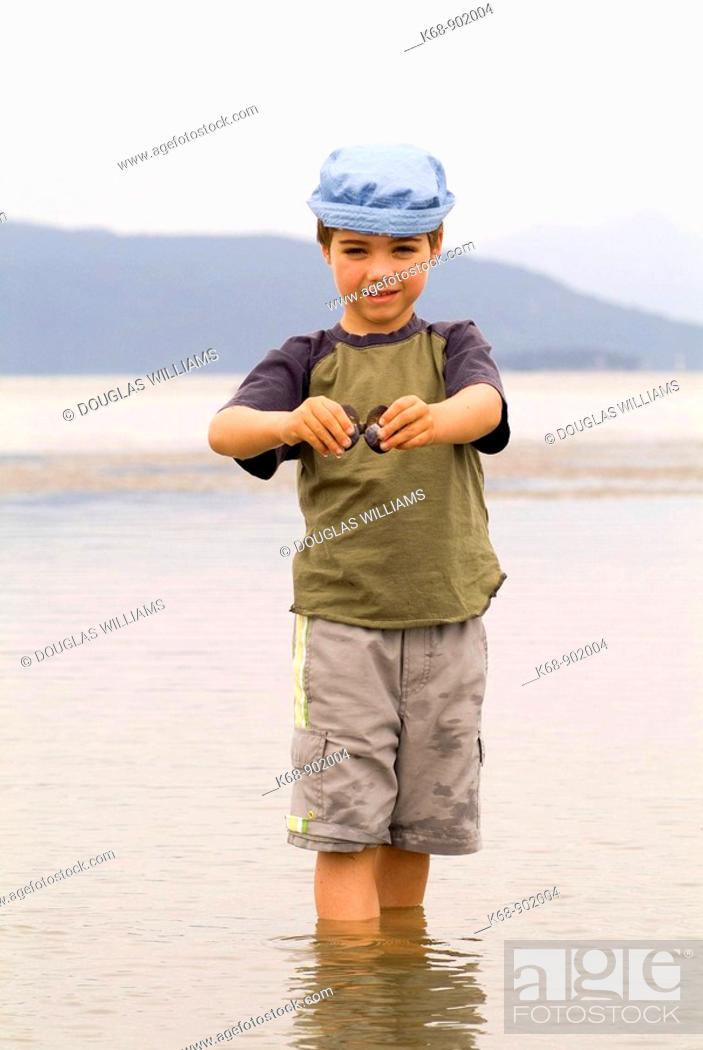 Stock Photo: five year old boy at Spanish Banks, Vancouver, BC, Canada.