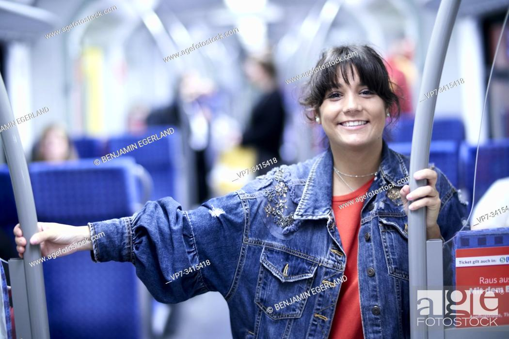 Stock Photo: Young woman in subway, Munich, Germany.