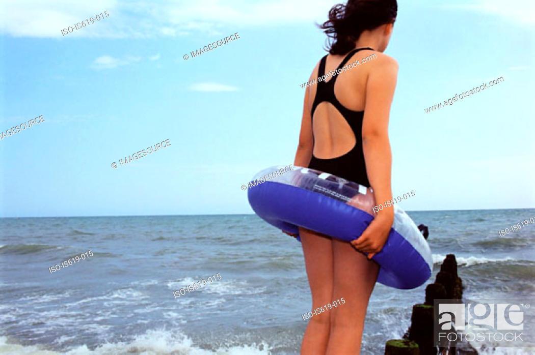 Stock Photo: Girl standing near sea.