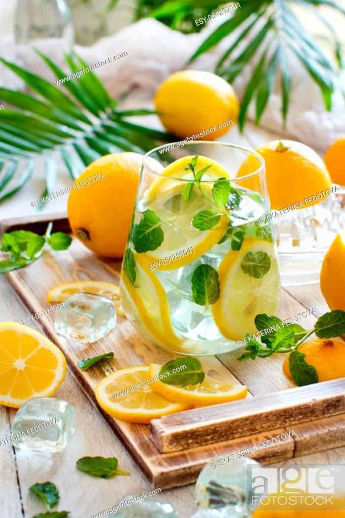Stock Photo: Homemade refreshing lemonade made from citrus fruits close up.