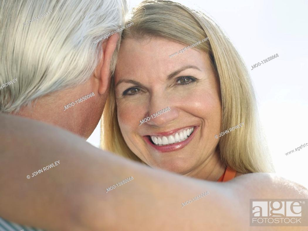 Stock Photo: Woman embracing man portrait close up.