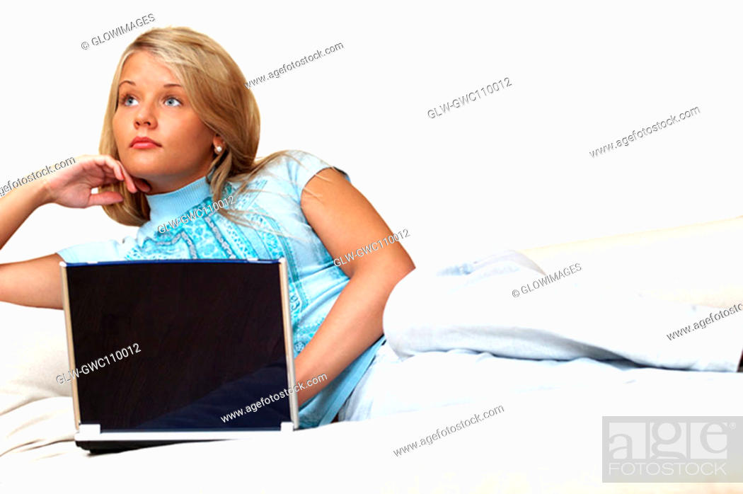Stock Photo: Businesswoman reclining in front of a laptop.