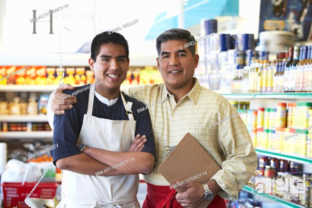 Stock Photo: Hispanic father and son in family owned bodega.