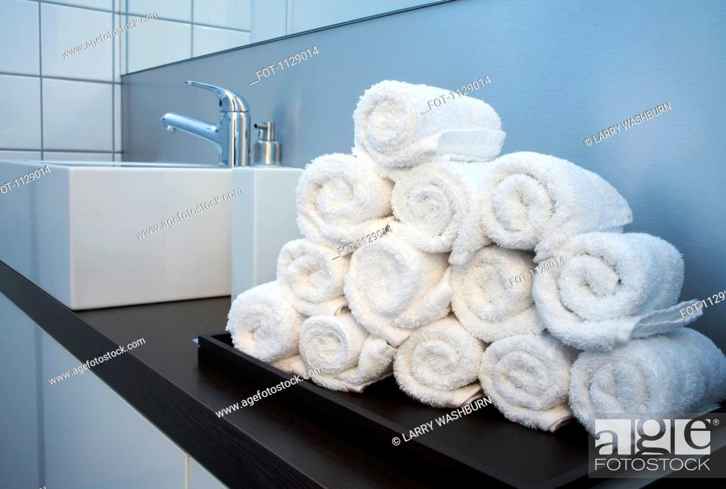 Stock Photo: Rolled towels stacked in the shape of a pyramid.