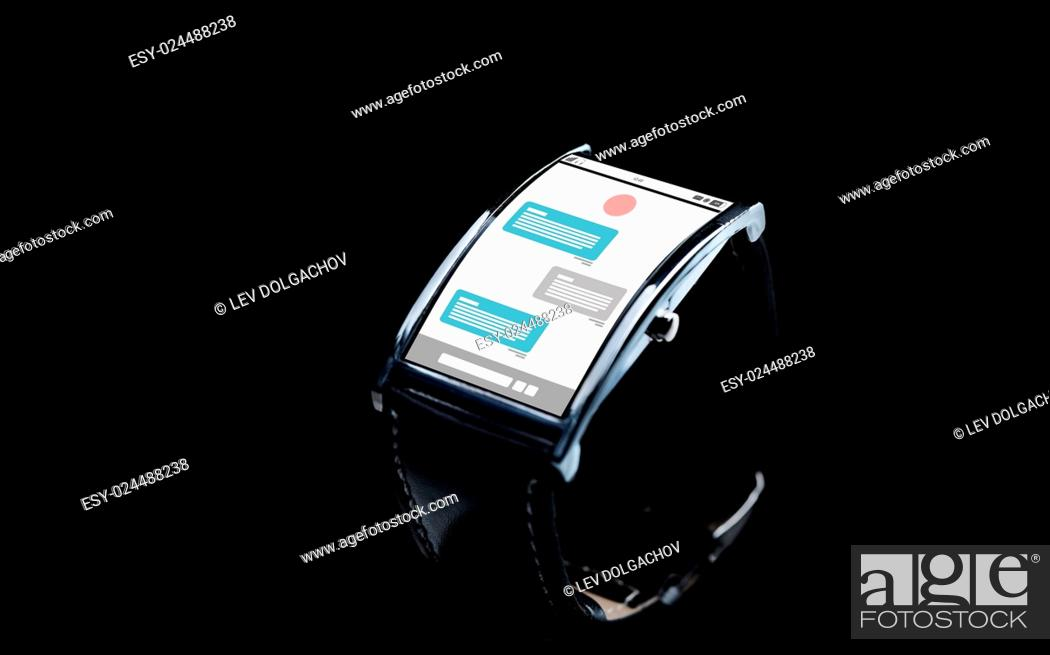 Stock Photo: modern technology, online communication, object and media concept - close up of black smart watch with messenger application on screen.