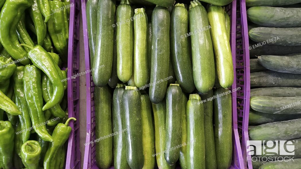 Stock Photo: Cucumbers, courgettes and peppers for sale.