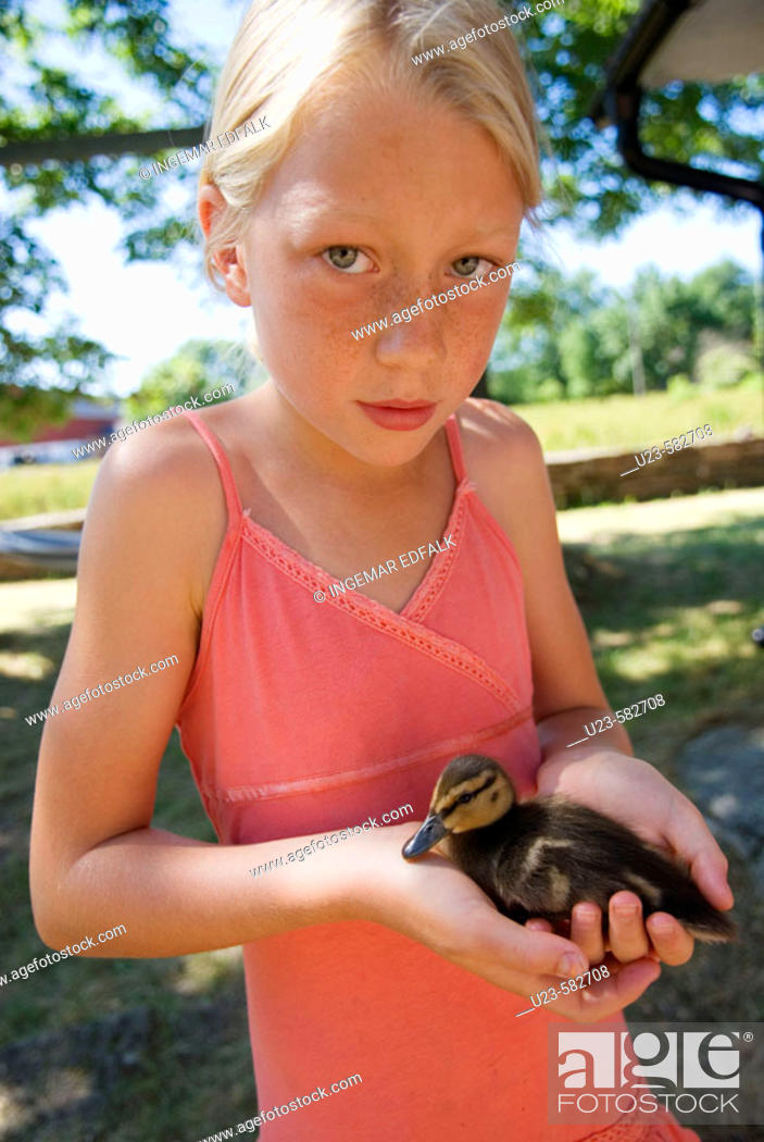 Stock Photo: Girl with baby duck.