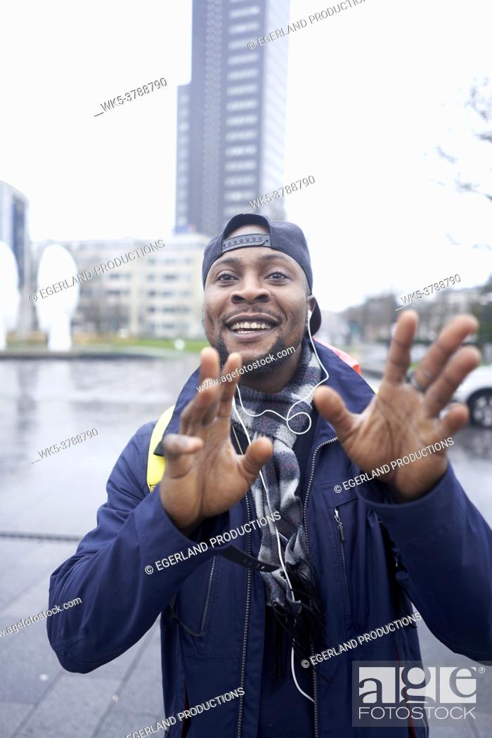 Stock Photo: optimistic African man with big dreams, ideas and visions in Leeuwarden, Friesland, Netherlands.