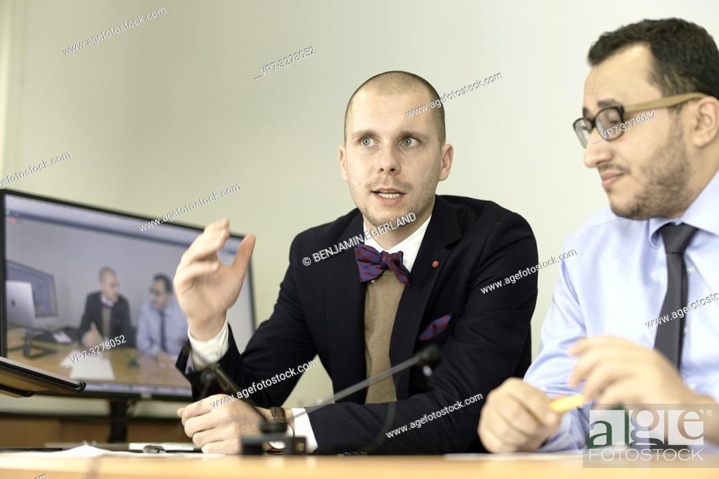 Imagen: business men discussing at conference, lawyers consulting at online live stream, in office, in Cottbus, Brandenburg, Germany.