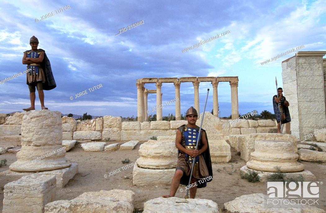 Stock Photo: Syrians dressed as Roman in the ancient Aramaic city of Palmyra. Tadmur, Syria. UNESCO World Heritage Site.