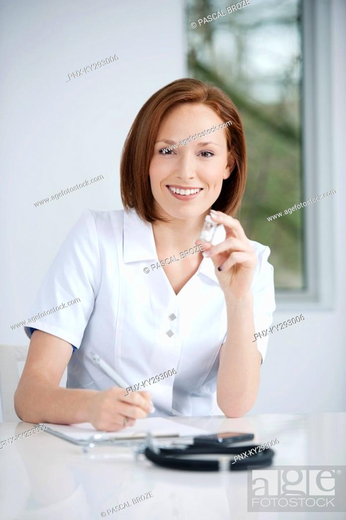 Stock Photo: Female doctor working in an office.