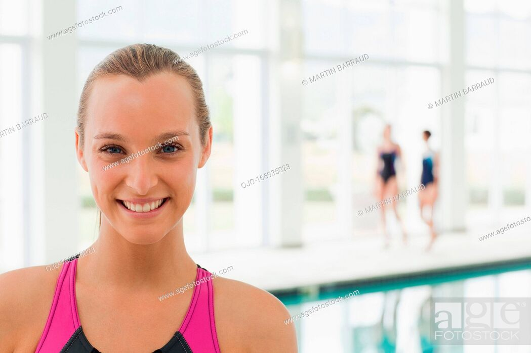 Stock Photo: Portrait of smiling woman at swimming pool.