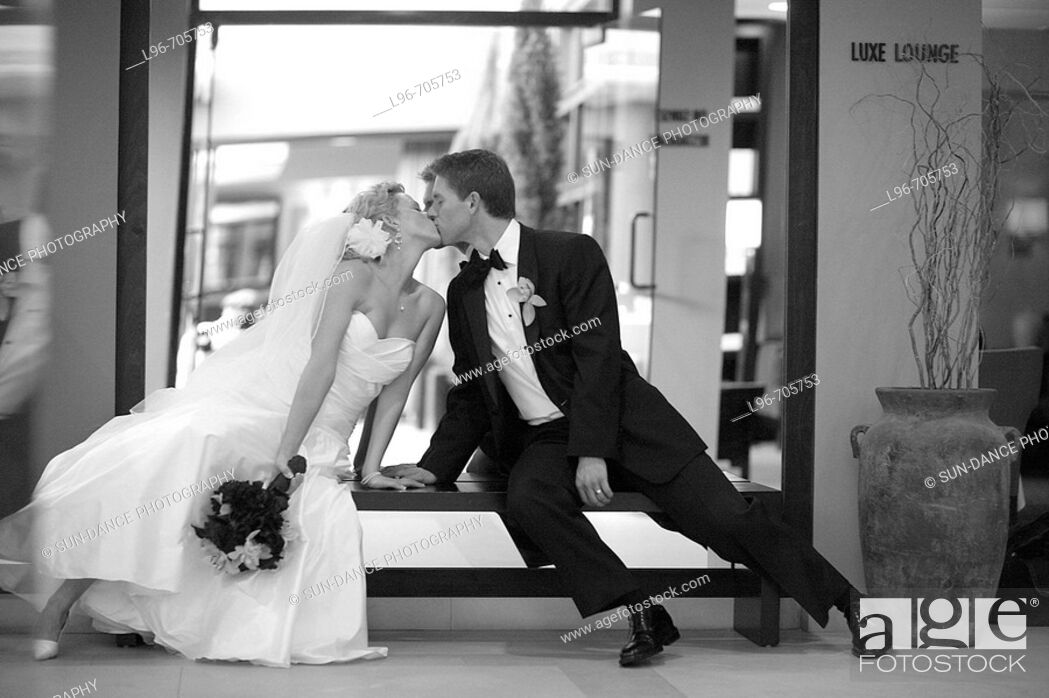 Stock Photo: dramatic bride and groom reaching toward each other to kiss.