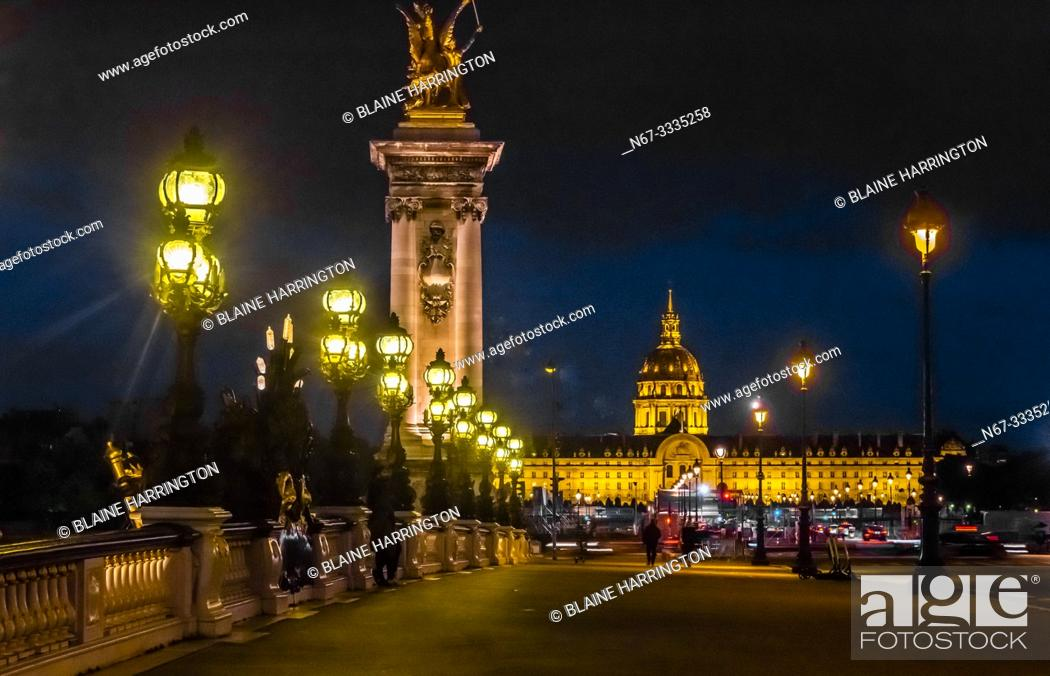Stock Photo: Pont Alexandre III (bridge) with its Art Nouveau lamps and behind, gilded sculptures with winged horses and in background Hotel des Invalides, Paris, France.