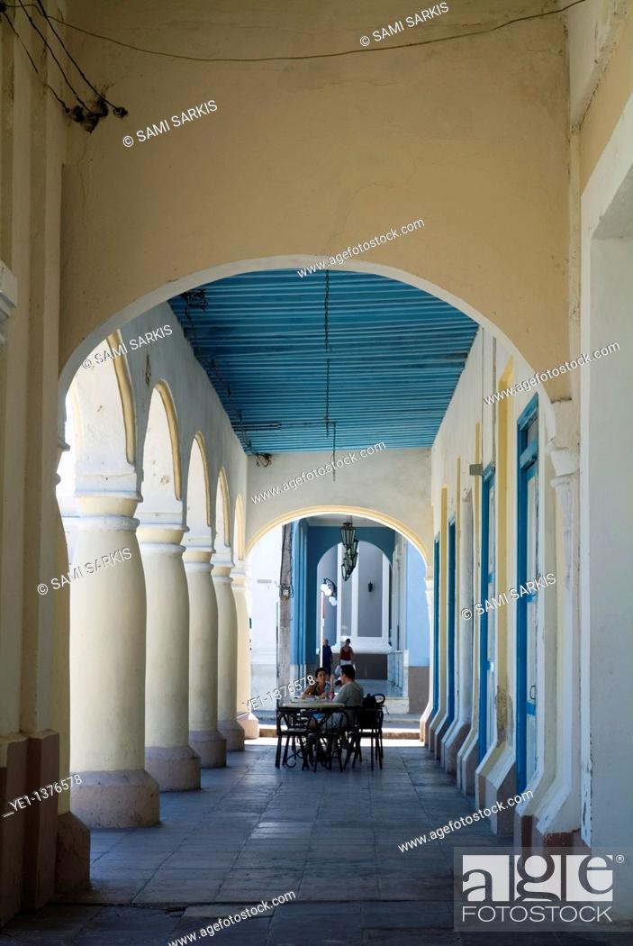 Stock Photo: Customers sitting at the outdoor patio tables of a cafe on Parque Jose Marti, Cienfuegos, Cuba.