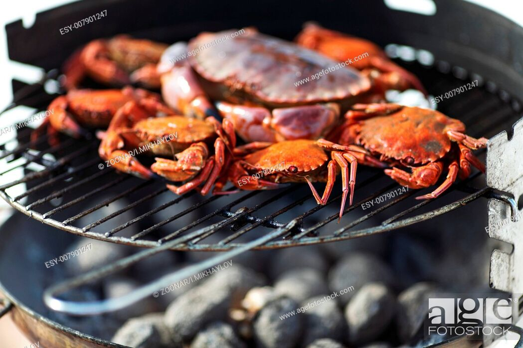 Stock Photo: crab on charcoal grill.