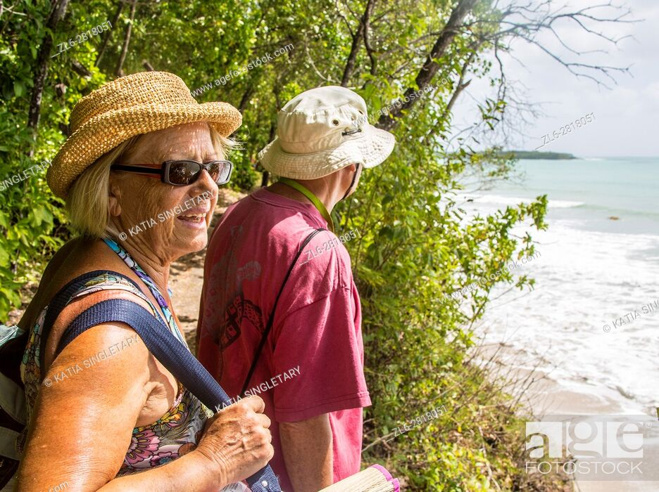 Stock Photo: Older retired caucaisian couple going to the beach in the tropical island of Martinique.