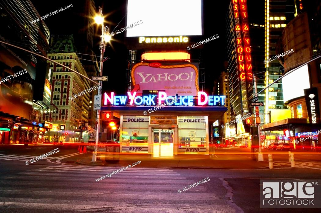 Stock Photo: Building lit up at night in a city, Times Square, Manhattan, New York City, New York State, USA.