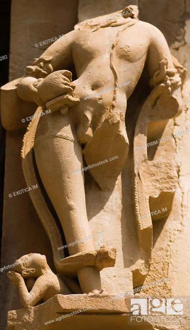 Stock Photo: Sculpture detail of a temple, Khajuraho, Chhatarpur District, Madhya Pradesh, India.