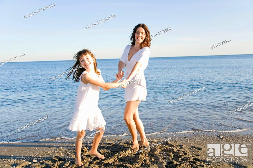 Stock Photo: Mother and daughter having fun at the beach.