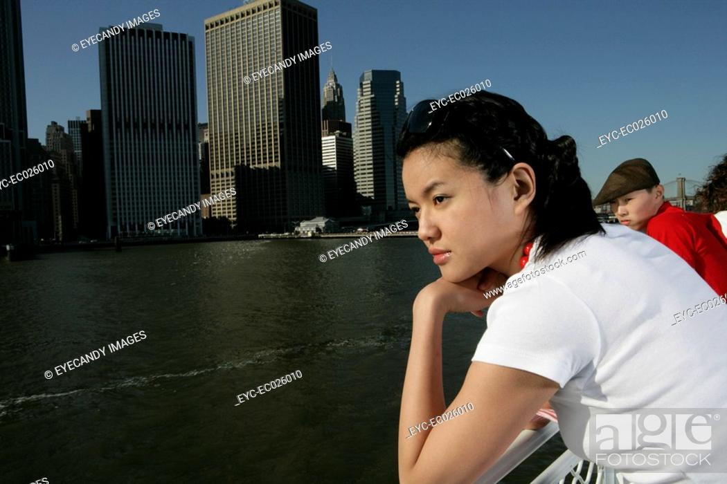 Stock Photo: Young woman sightseeing on a ferrboat.