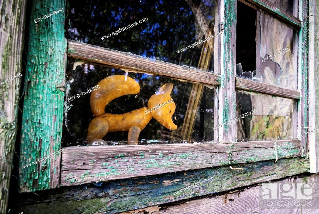 Stock Photo: Plastic toy in abandoned house in Mashevo village of Chernobyl Nuclear Power Plant Zone of Alienation area around nuclear reactor disaster in Ukraine.