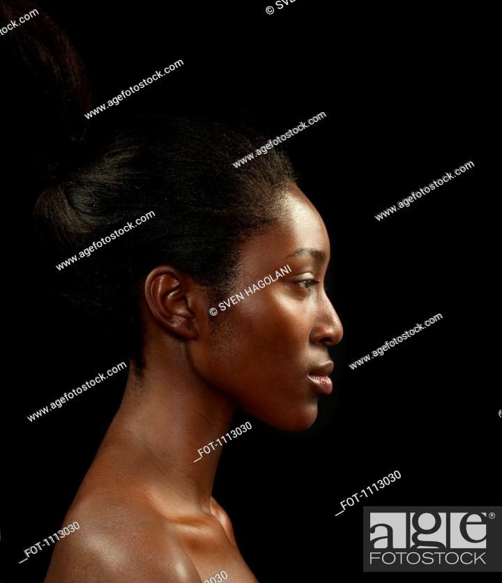 Stock Photo: Profile, head and shoulders portrait of a beautiful woman.